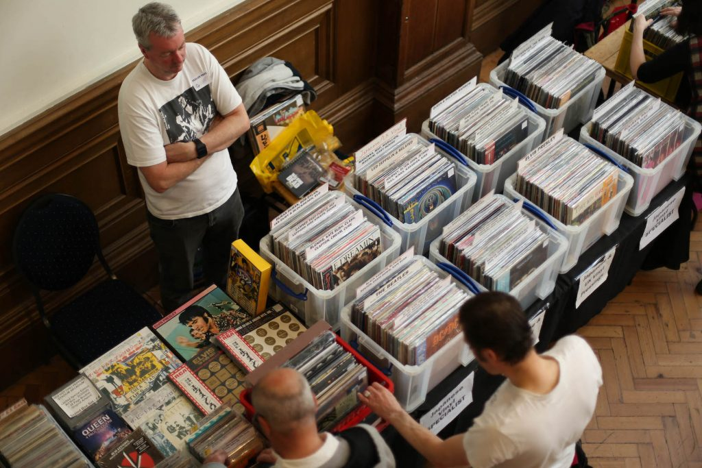 stallholder and buyers at a VIP record fair
