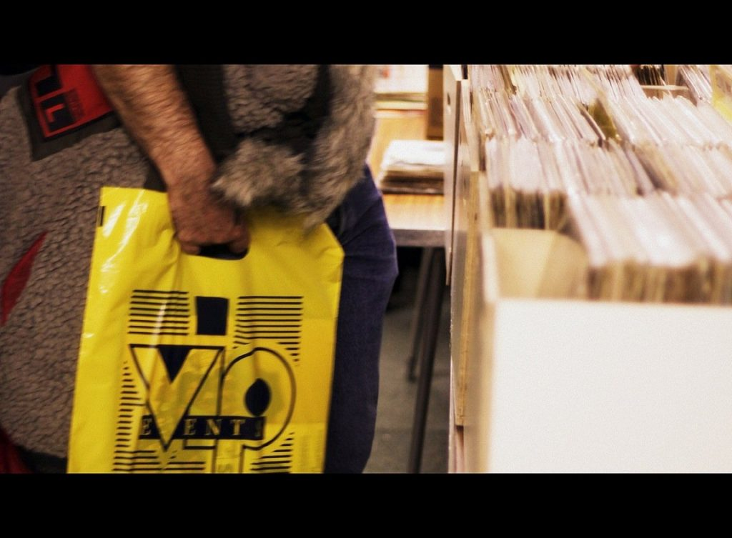 vinyl buyer with the iconic VIP carrier bag